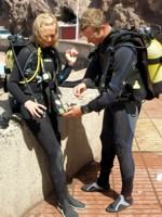 A buddy check before the dive is part of the overall safety management