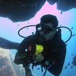 Scuba Diving underwater in Gran Canaria - Divemaster with torch