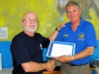 Padi certificate of excellence awarded by PADI Regional Manager Christian Marret to Davy Jones Diving